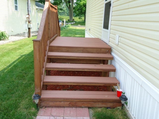Composite deck stairway entry for Redwood vs composite decking