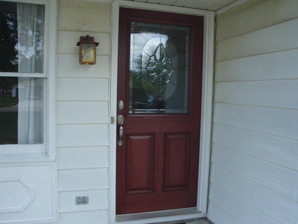 What A Great Looking Door! It Comes From ThermaTruu0027s Fiber Classic Mahogany  Collection, And Features Two Raised Panels W. Decorative Glass.
