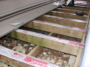 We use sticky window flashing on the joists to prevent further water penetration.