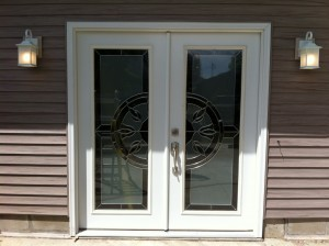Great looking patio door with new entry lights!