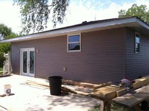 Former garage door area now holds a sweet patio door!