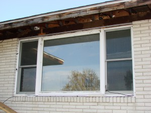 BEFORE - Drafty, single pane, picture window with double hung on each side