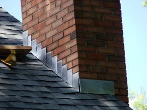 Fresh coat of alum paint on the chimney flashing - a free service!