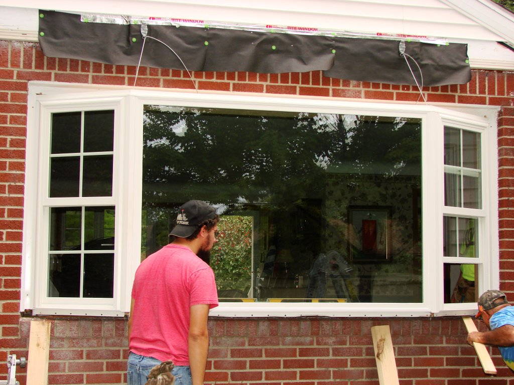 Bay window installation roof construction bryan ohio for What to put in front of a bay window