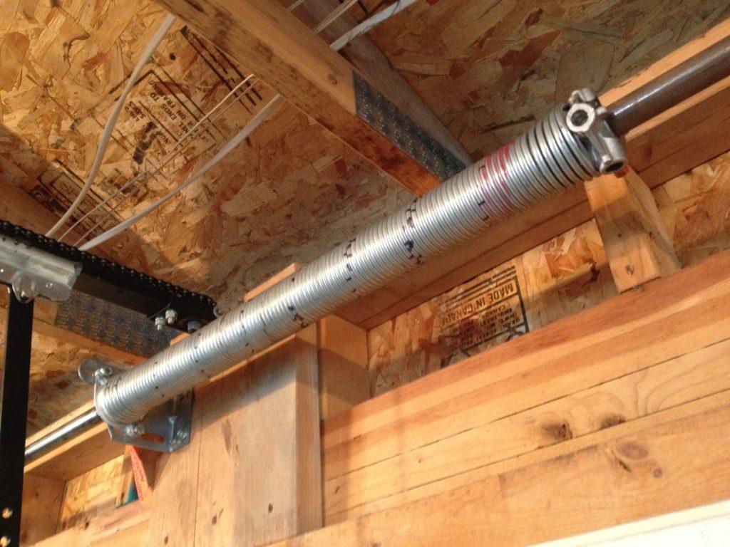 Garage Door Tension Spring : Torsion spring replacement garage door hicksville