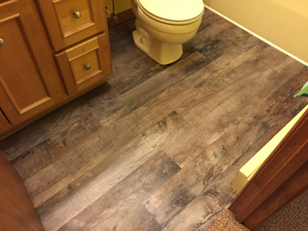 Luxury vinyl plank flooring cost diy install vinyl plank for Luxury linoleum flooring